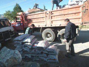 Şehit ve gazi ailelerine kömür ve nakdi yardım