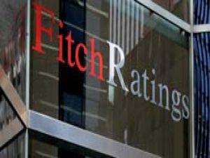Fitch, 8 büyük bankanın kredi notunu düşürdü