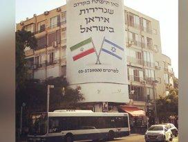 İsrailde bir pankart:İran elçiliği yakında burada