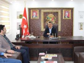 Yazar Mahmut Uludan Başkan Tutala ziyaret